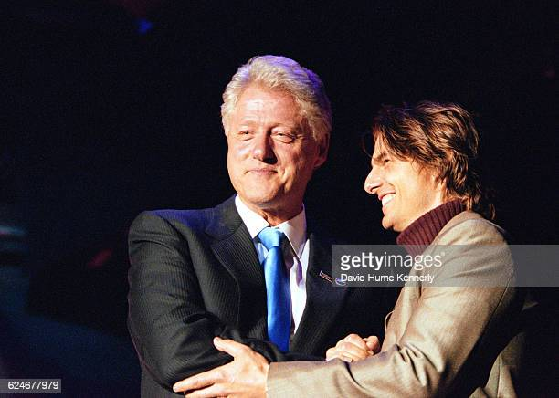 President Bill Clinton on stage with Tom Cruise at the 53rd birthday party for his wife Hillary Clinton at the Rosebud Club in New York City on...