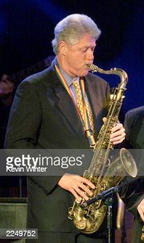 President Bill Clinton plays the sax at 'A Family Celebration 2001' at the Regent Beverly Wilshire Hotel Beverly Hills Ca 4/1/01 Los Angeles Photo by...