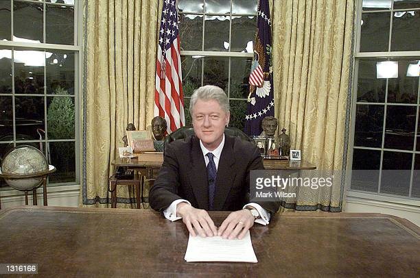 President Bill Clinton poses for photographers January 18 2001 after delivering his farewell address to the nation Presidentelect Bush will take the...