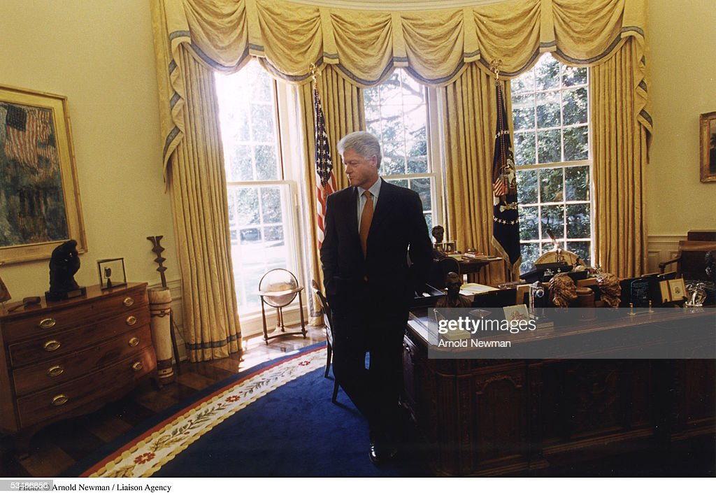 clinton oval office. us president bill clinton poses for portrait in the oval office august 17 1999