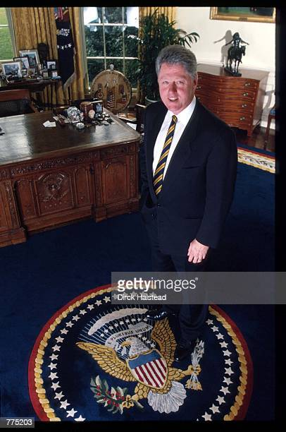 President Bill Clinton poses in the Oval Office February 15 1995 in Washington DC Clinton formerly the Governor of Arkansas was the first Democrat...