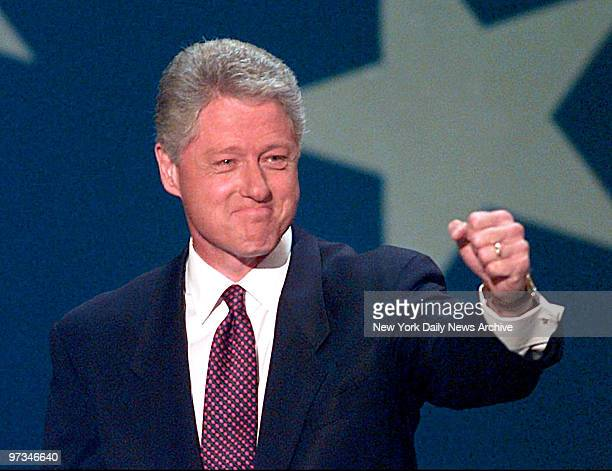 President Bill Clinton raises his hand to the crowd before giving his acceptance speech Thursday night at the1996 Democratic National Convention at...