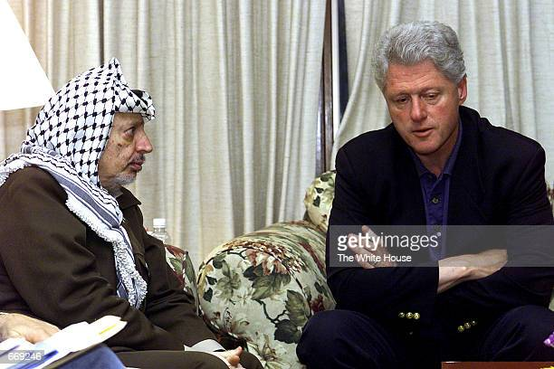S President Bill Clinton right speaks with Palestinian Chairman Yasser Arafat during summit meetings July 19 2000 at Camp David MD Peace talks...