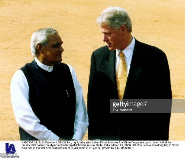 S President Bill Clinton right talks with Indian Prime Minister Atal Bihari Vajpayee upon his arrival at the presidential palace courtyard of...