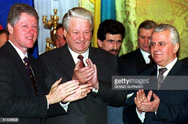 US President Bill Clinton Russian President Boris Yeltsin and Ukrainian President Leonid M Kravchuk clap their hands after signing the nuclear...