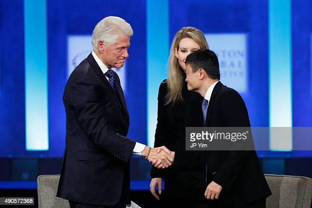 S President Bill Clinton shakes hands with Jack Ma Executive Chairman of Alibaba Group during the closing session of the Clinton Global Initiative...