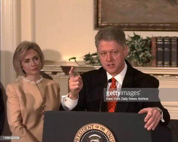 President Bill Clinton shakes his finger as he denies improper behavior with Monica Lewinsky in the White House Roosevelt Room 'I did not have sexual...