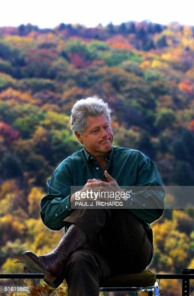 President Bill Clinton sits atop Reddish Knob Overlook in the George Washington and Jefferson National Forest in Virginia 13 October 1999 President...
