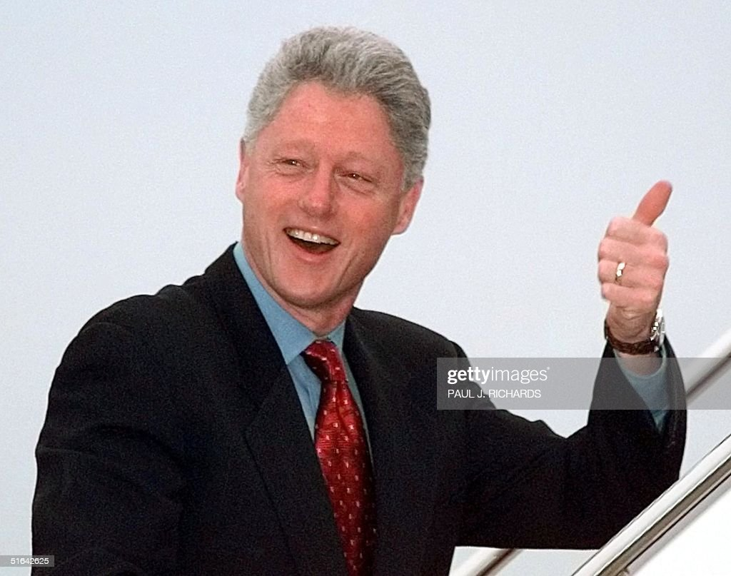 US President Bill Clinton smiles and gives the 'Thumbs Up' sign while boarding Air Force One 0 February at Andrews Air Force Base near the nation's capital en route to Los Alamos, New Mexico. Clinton stepped up his drive to ban nuclear testing worldwide, showcasing a simulated blast at the Los Alamos National Laboratory, where the first nuclear bombs were created during World War II.