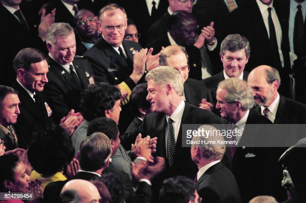 President Bill Clinton speaks with lawmakers following his State of the Union Speech before a joint session of Congress Washington DC January 19 1999