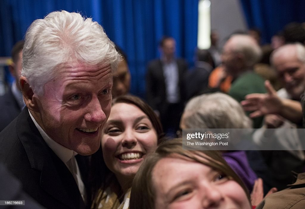 President Bill Clinton takes a picture with an excited supporters after a Virginia gubernatorial candidate Terry McAuliffe campaign event in Harrisonburg, Virginia on Tuesday October 29, 2013. The old friends and political teammates have been traveling through the Commonwealth campaigning since Sunday, and will end the tour tomorrow evening in Roanoke.