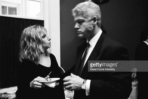 President Bill Clinton talks with singersongwriter Barbra Streisand on election night backstage at the Old State House Little Rock Arkansas November...
