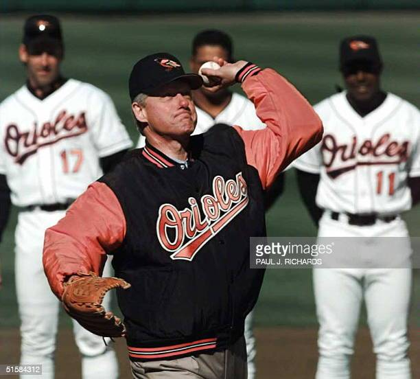 President Bill Clinton throws the ceremonial first pitch at Camden Yards 02 April as the Baltimore Orioles open their '96 season against the Kansas...