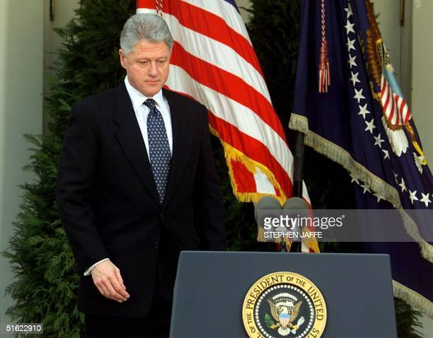 President Bill Clinton walks to the podium moments before reading a statement in the Rose Garden of the White House after the Senate voted not to...