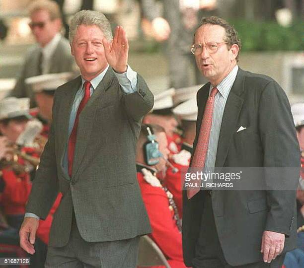 President Bill Clinton waves to photographers as he walks with John Deutch director of the CIA during ceremonies at CIA Headquarters in Langley VA 14...