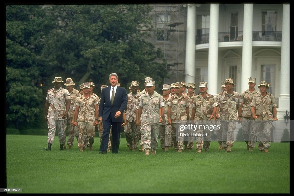 President Bill Clinton with a contingent of camouflageclad Marine and Army soldiers recently returned from Somalia during a ceremony honoring...