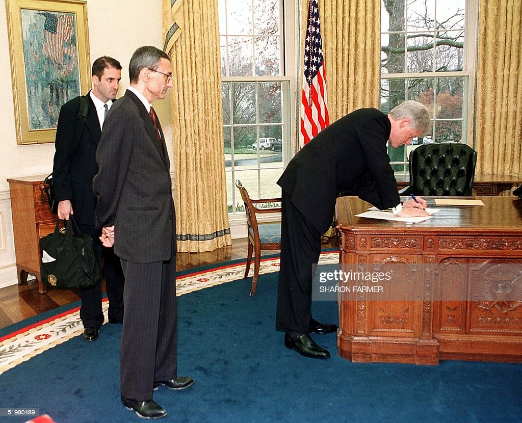 us president bill clinton work at his desk in the oval office before white house chief bill clinton oval office