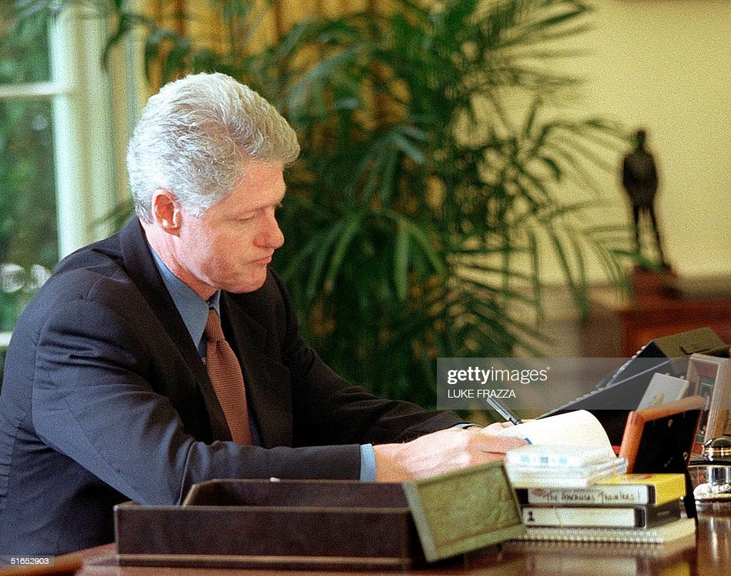 us president bill clinton works on a speech 05 june in the oval office at the bill clinton oval office