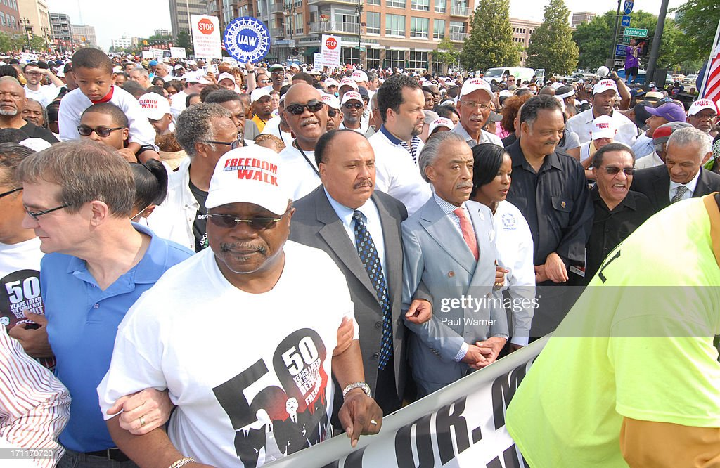 UAW president Bob King, Detroit NAACP President Wendell Anthony, Reverend Martin Luther King Jr's son Martin Luther King III, Reverend Al Sharpton, Reverend Jesse Jackson and march grand marshal Tony Brown march during the 50th Anniversary Freedom March on June 22, 2013 in Detroit, Michigan.