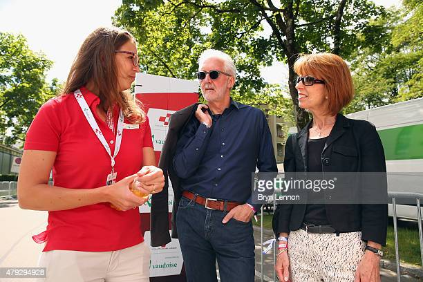 President Brian Cookson and his wife Sian attend the penultimate stage of the Tour de Suisse in Bern on June 20 2015 in Bern