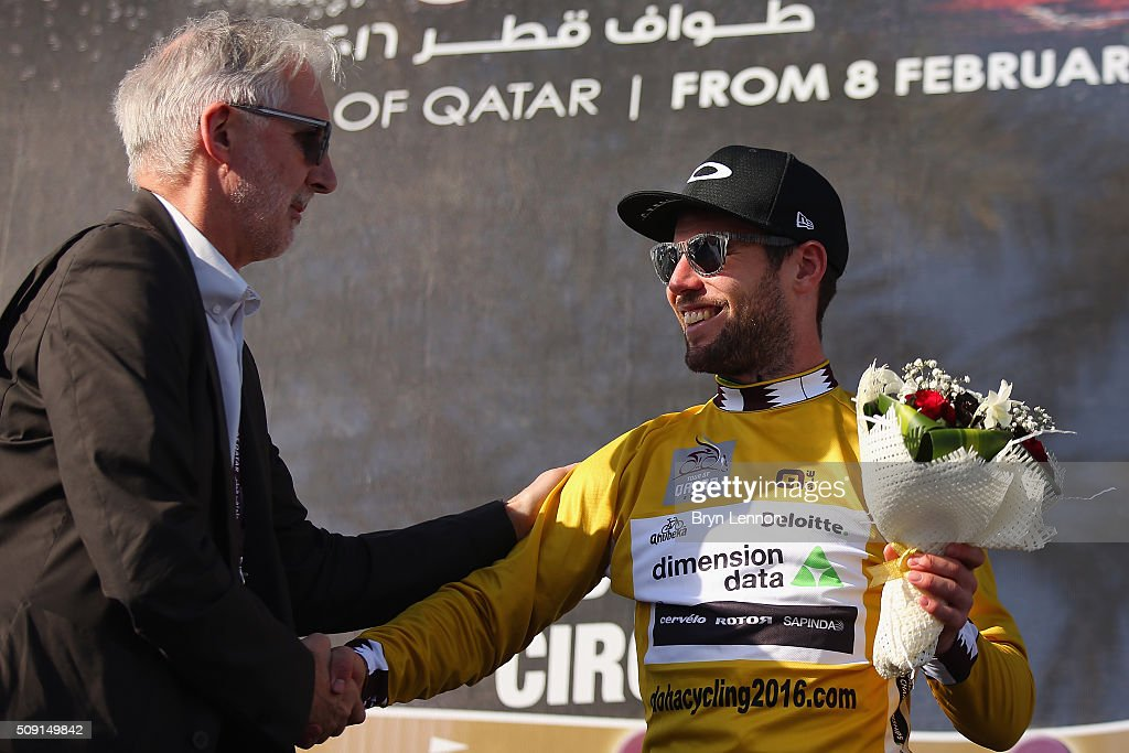 UCI president <a gi-track='captionPersonalityLinkClicked' href=/galleries/search?phrase=Brian+Cookson&family=editorial&specificpeople=8909757 ng-click='$event.stopPropagation()'>Brian Cookson</a> congratulates <a gi-track='captionPersonalityLinkClicked' href=/galleries/search?phrase=Mark+Cavendish&family=editorial&specificpeople=684957 ng-click='$event.stopPropagation()'>Mark Cavendish</a> of Great Britain and Dimension Data on retaining his leaders gold jersey after stage two of the 2016 Tour of Qatar from Qatar University to Qatar Univeristy on February 9, 2016 in Doha, Qatar. The stage also serves as a test event for the World Road Race Championships which will be held in Doha in October.