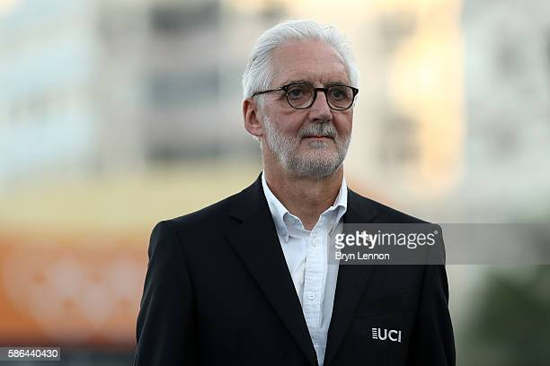 President Brian Cookson stands during the medal ceremony for the Men's Road Race on Day 1 of the Rio 2016 Olympic Games at the Fort Copacabana on...