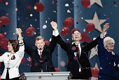 President Bush and Vice President Dan Quayle stand with their wives Barbara and Marilyn respectively while confetti rains down on them during a...