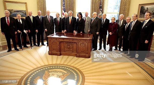President Bush pauses for a photograph on Thursday January 5 with present and former Secretaries of State and Defense in the Oval Office at the White...