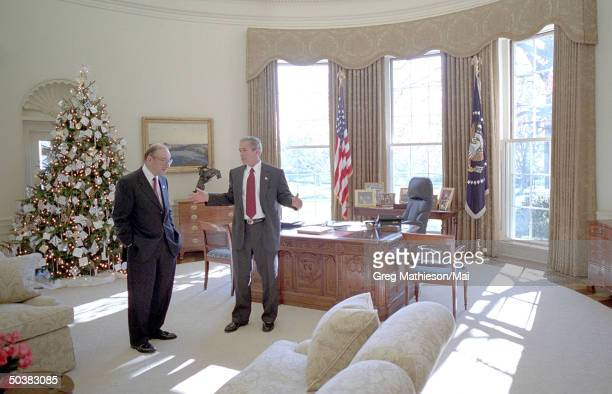 President Bush talking to Federal Reserve Chairman Alan Greenspan in the Oval Office