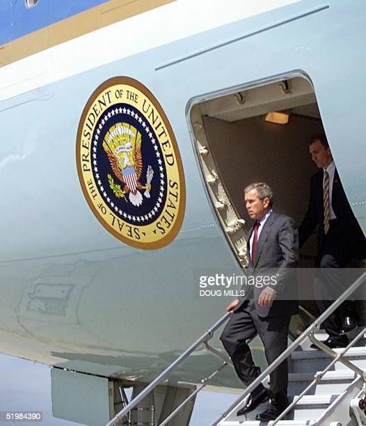 President Bush walks off the steps of Air Force One at Offutt Air Force Base near Omaha Nebraska to have a National Security breifing about the two...