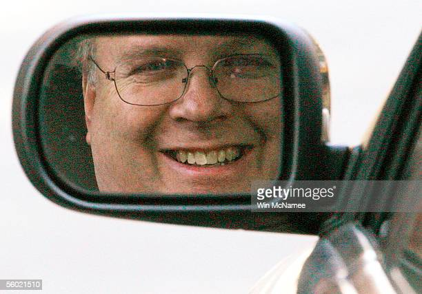 President Bush's senior advisor and Deputy Chief of Staff Karl Rove looks through his sideview mirror as he arrives at the West Wing of the White...