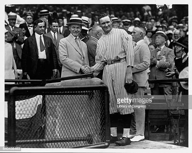 President Calvin Coolidge shakes hands with Bucky Harris 2nd baseman and manager for the Washington Senators