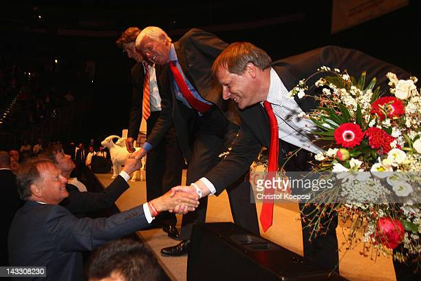 President candidate KarlHeinz Thielen congratulates Toni Schumacher Werner Spinner and Markus Ritterbach after bein voted during the extraordinary...