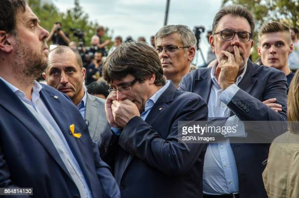 President Carles Puigdemont answers a phone call during the rally art Passeig de Gràcia About 450000 people have been focused to support the...