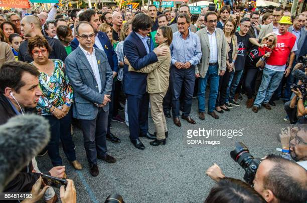 President Carles Puigdemont embraces Carmen Forcadell President of the catalan Parliament About 450000 people have been focused to support the...