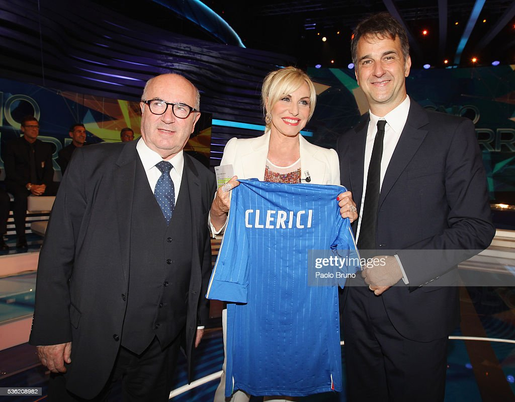 President <a gi-track='captionPersonalityLinkClicked' href=/galleries/search?phrase=Carlo+Tavecchio&family=editorial&specificpeople=5365308 ng-click='$event.stopPropagation()'>Carlo Tavecchio</a>, Tv presenter <a gi-track='captionPersonalityLinkClicked' href=/galleries/search?phrase=Antonella+Clerici&family=editorial&specificpeople=2544073 ng-click='$event.stopPropagation()'>Antonella Clerici</a> and FIGC General Director Michele Uva pose with Italian jersey during the 'Sogno Azzurro' TV programme at Auditorium del Foro Italico on May 31, 2016 in Rome, Italy.
