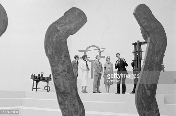 President Carter accepted for the nation on June 1 the new East Wing of the National Gallery of Art Framed by a piece of sculptor left to right are...
