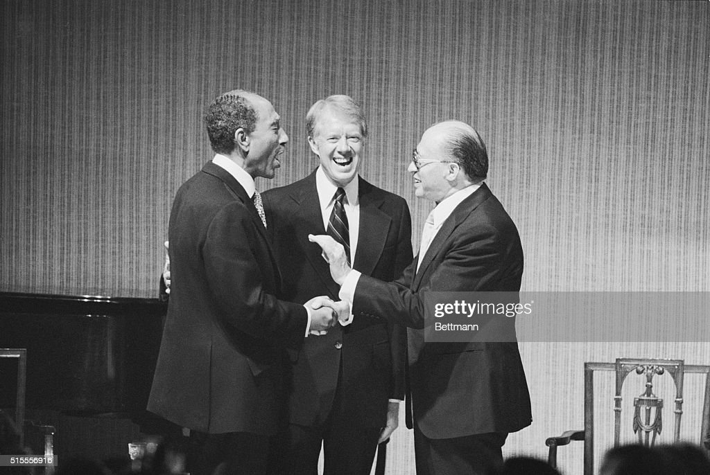 President Carter, President Sadat and Prime Minister Begin share a laugh at a State Dinner honoring the Egyptian and Israeli leaders at the White House after the earlier signing of the peace treaty between their two nations.