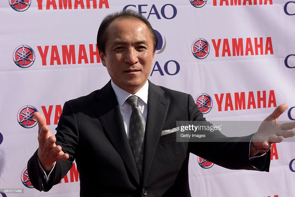 President, CEO and Representative Director Yamaha Motor, <a gi-track='captionPersonalityLinkClicked' href=/galleries/search?phrase=Hiroyuki+Yanagi&family=editorial&specificpeople=2322752 ng-click='$event.stopPropagation()'>Hiroyuki Yanagi</a> arrives for the opening ceremony of CFAO Yamaha factory on May 13, 2016 in Lagos, Nigeria. Japanese Yamaha Motor Co and French company CFAO establish a joint venture motorcycle manufacturing and sales company in Nigeria.