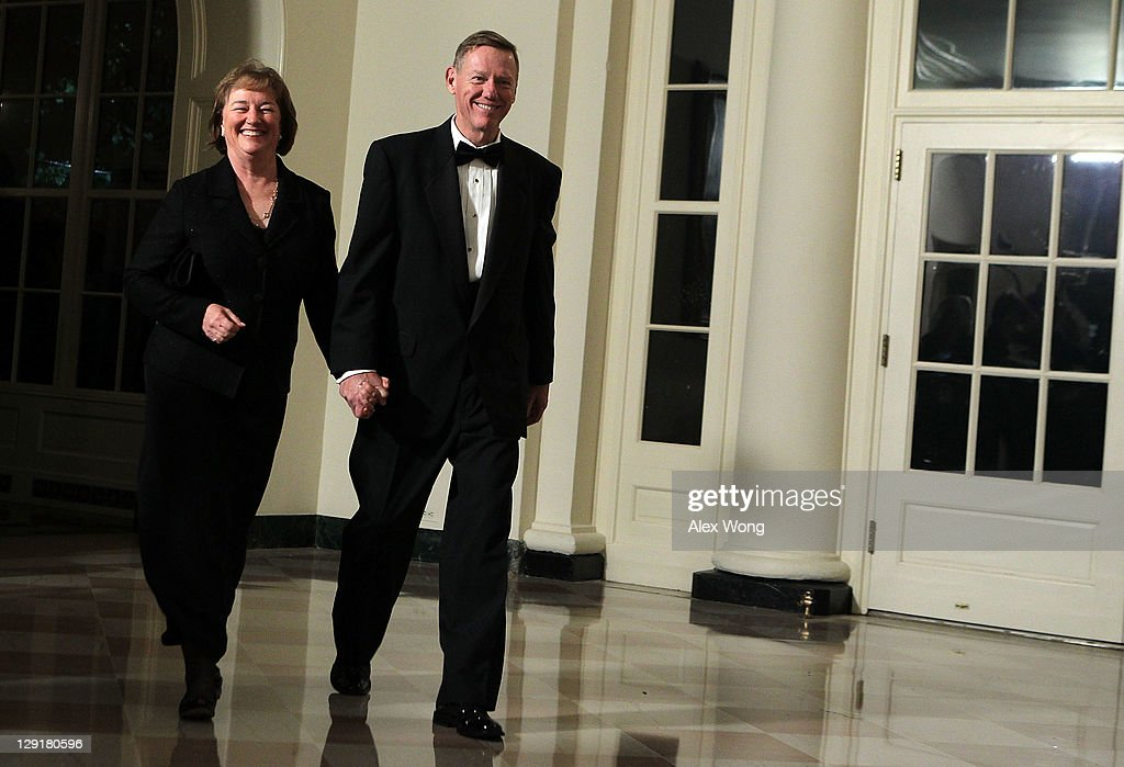 President & CEO of Ford Motor Company Alan Mulally (R) and his wife Nicki (L) arrive at a state dinner at the White House October 13, 2011 in Washington, DC. President Barack Obama hosted a state dinner in honor of South Korean President Lee Myung-bak and his wife Kim Yoon-ok.