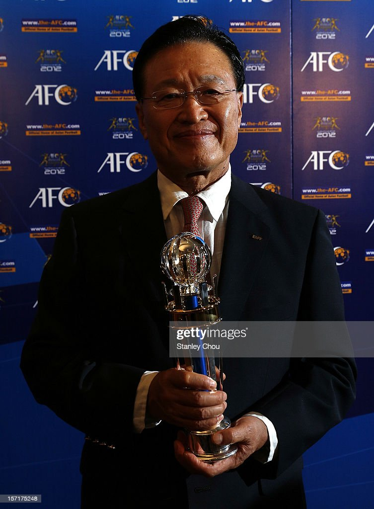 President Cho Chung Yun poses with 2012 AFC National Team of the Year Award (Men) during the 2012 AFC Annual Awards at the Mandarin Oriental Hotel on November 29, 2012 in Kuala Lumpur, Malaysia.