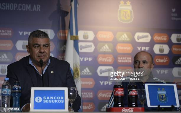 AFA president Claudio Tapia speaks next to Argentine football team's new coach Jorge Sampaoli during a press conference in Ezeiza Buenos Aires...