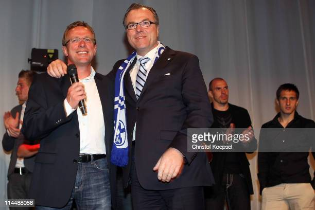 President Clemens Toennies mand head coach Ralf Rangnick sing during the celebration after the DFB Cup final match between MSV Duisburg and FC...