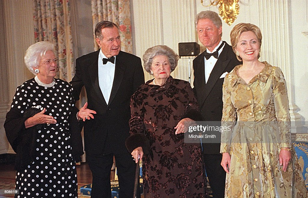 President Clinton and former President George Bush escort Lady Bird Johnson Barbara Bush and Hillary Rodham Clinton from the State Dinning Room of...