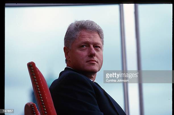 President Clinton poses during his trip July 10 1997 in Warsaw Poland Walesa's Solidarity party and the Communist party created a coalition...