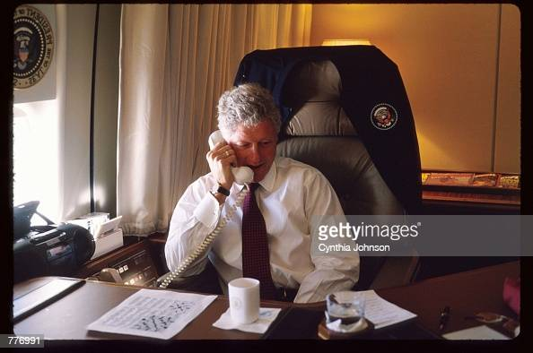 President Clinton speaks on the phone while on Air Force One November 2 1997 in the United States The President spent the day campaigning in the...