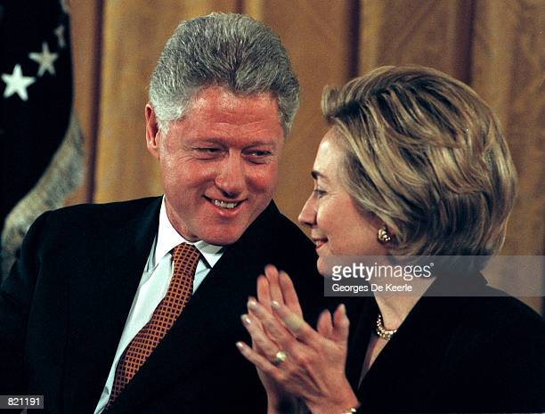 President Clinton speaks with Hillary during an event about Social Security and Medicare in the East Room of the White House February 17 1999 Clinton...