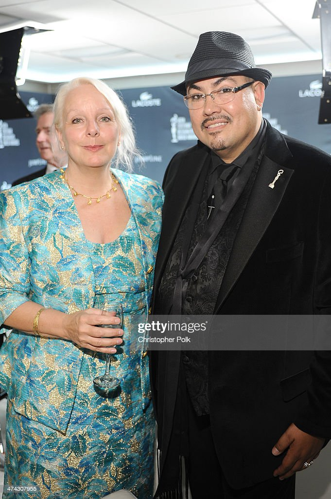 President, Costume Designer's Guild Salvador Perez (R) and costume designer Claire Nadon attend the 16th Costume Designers Guild Awards with presenting sponsor Lacoste at The Beverly Hilton Hotel on February 22, 2014 in Beverly Hills, California.