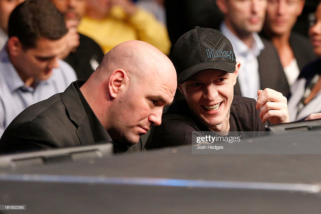 UFC President Dana White and DJ/music producer Joel Thomas 'Deadmau5' Zimmerman enjoy the atmosphere during the UFC lightweight bout between Pat Healy and Khabib Nurmagomedov at the Air Canada Center on September 21, 2013 in Toronto, Ontario, Canada.