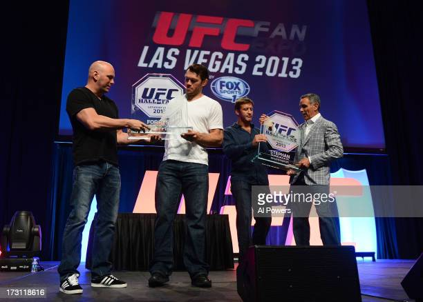 UFC president Dana White and television producer Craig Piligian present Forrest Griffin and Stephan Bonnar with their UFC Hall of Fame plaques during...